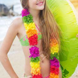 Cute Teen Girl Is Wearing Swimsuit and Hawaiian Colorful Flowers