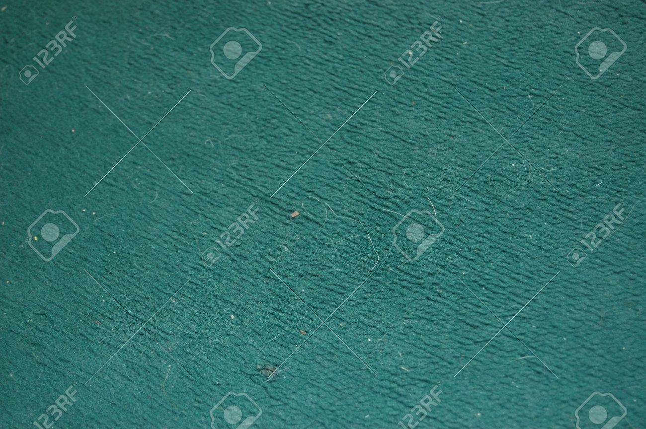 A Dirty Dark Green Carpet Texture With Hair And Bits On It Stock Photo