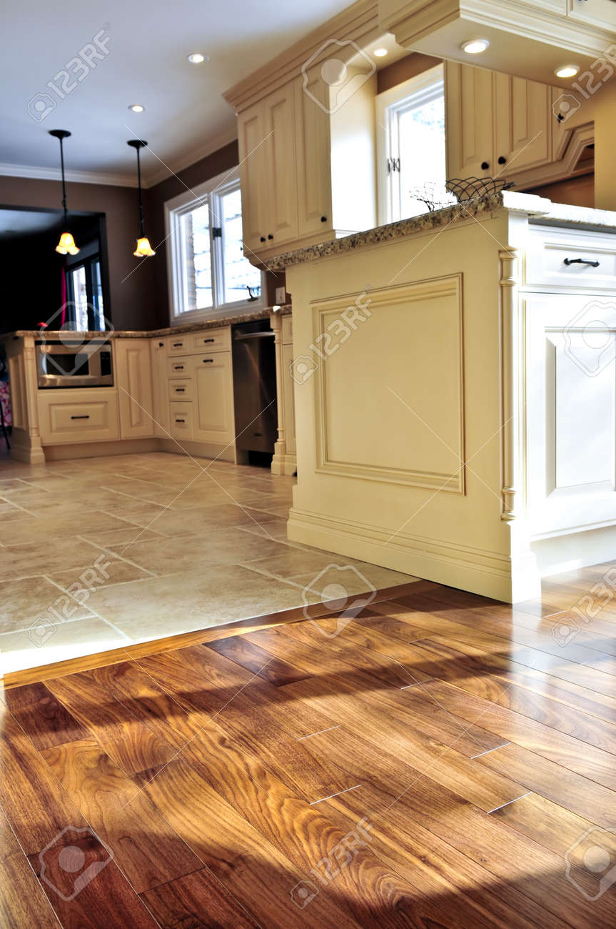 3942984 Hardwood and tile floor in residential home kitchen and dining room Stock Photo