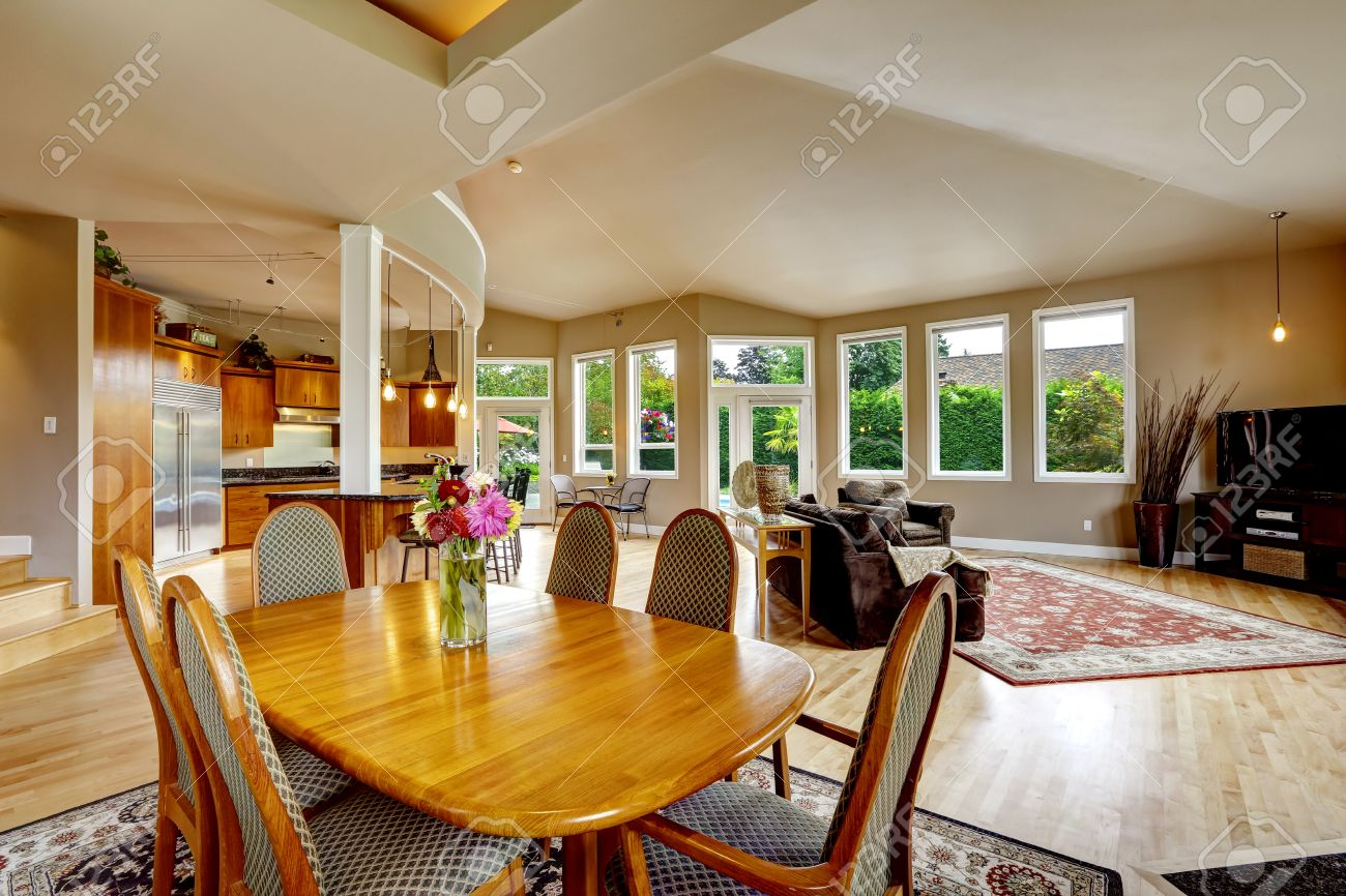 31387255 Spacious luxury house with open floor plan Living room with dining table set and separated kitchen s Stock Photo