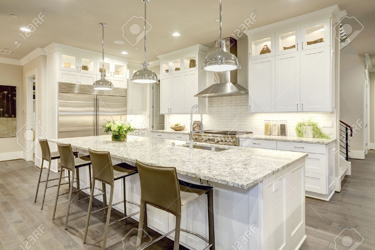 State Stock Photo Kitchen Design Features Large Bar Style Kitchen Islandwith Granite Counter Illuminated By Pendant Kitchen Design Features Large Bar Style Kitchen Stock kitchen White Kitchen Island Bar