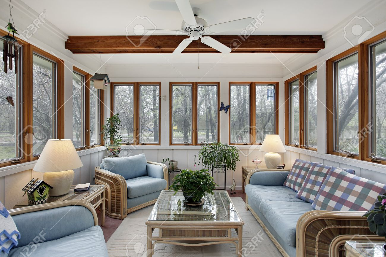 stock photo sunroom with wood ceiling beam and wicker furniture for r