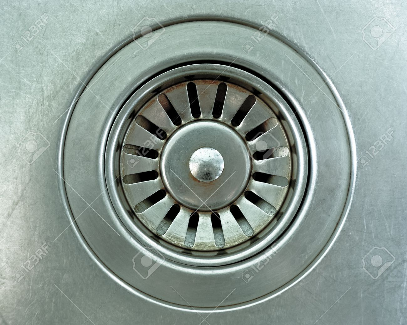 12984090 close up a drain hole metallic kitchen sink Stock Photo