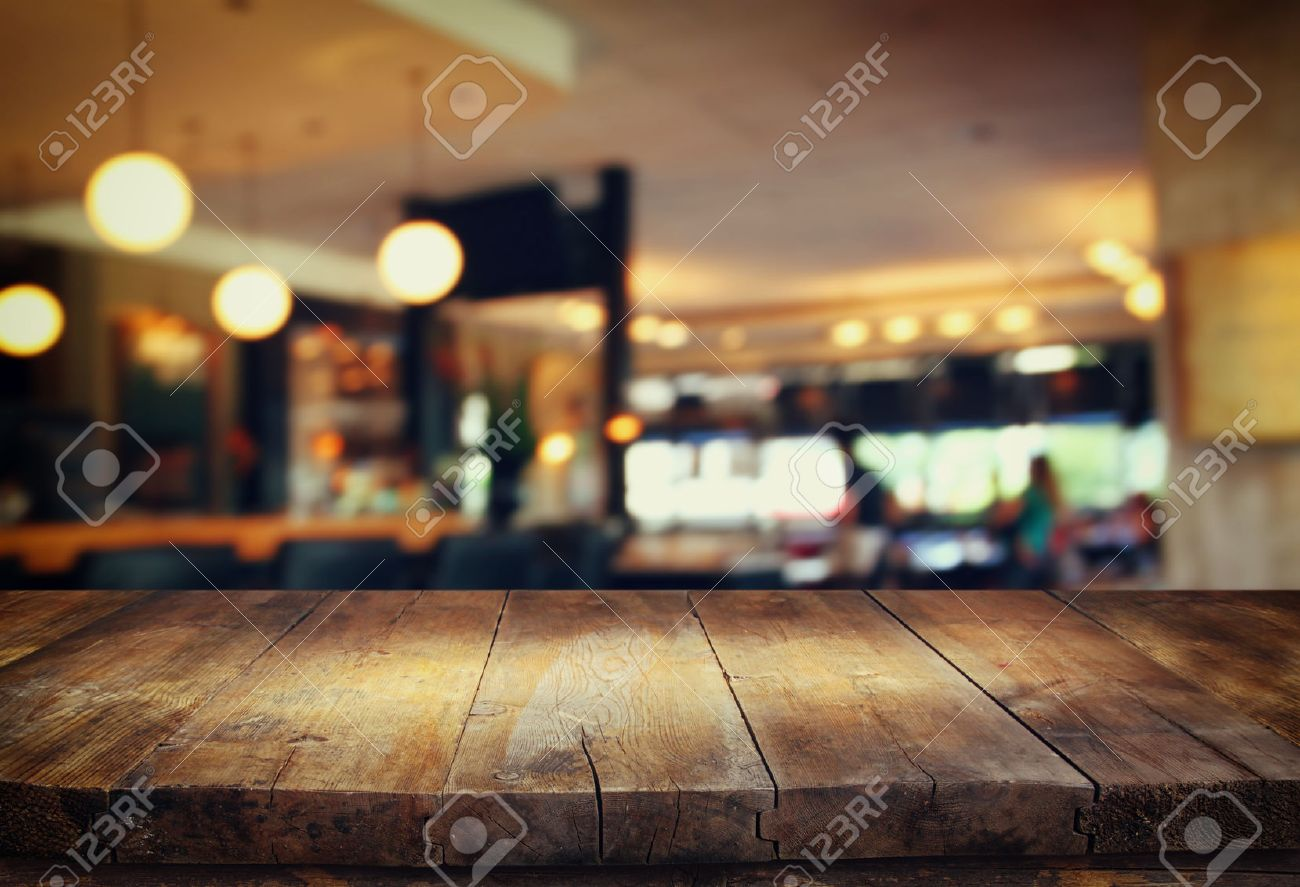 47272205 image of wooden table in front of abstract blurred background of restaurant lights Stock Photo