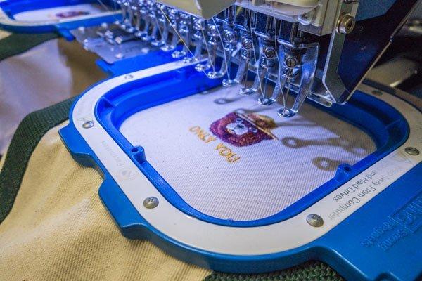 smokey bear on the embroidey machine