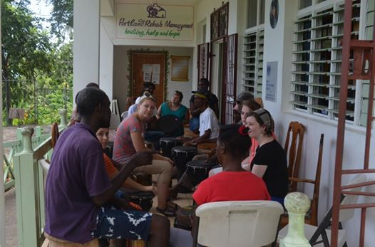 Volunteers teaching drumming lessons