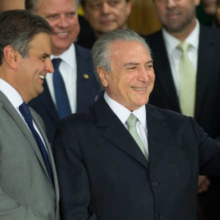 """Brazilian acting President Michel Temer (R) and Senator Aecio Neves during the new ministers inauguration ceremony at Planalto palace in Brasilia, on May 12, 2016. Temer said Thursday his new cabinet must work to restore the country's """"credibility,"""" in his first address after assuming power from suspended predecessor Dilma Rousseff pending her impeachment trial. / AFP / ANDRESSA ANHOLETE (Photo credit should read ANDRESSA ANHOLETE/AFP/Getty Images)"""