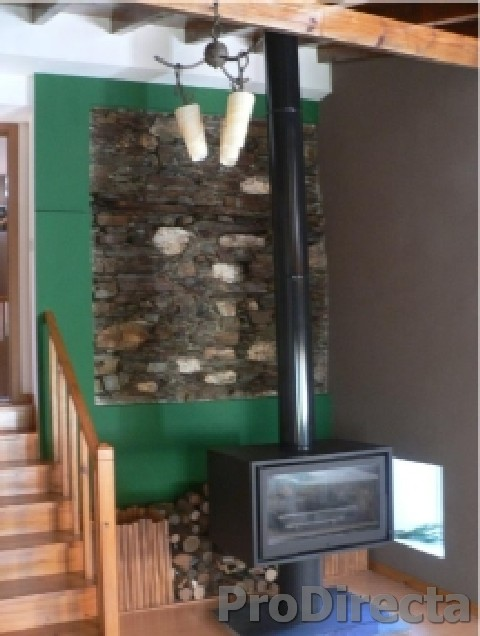 Living Room – Custom Made Double Wall Insulated Chimney System and Wood Burning Stove with Glass Doors Front and Back. Custom Designed and Built Firewood Box
