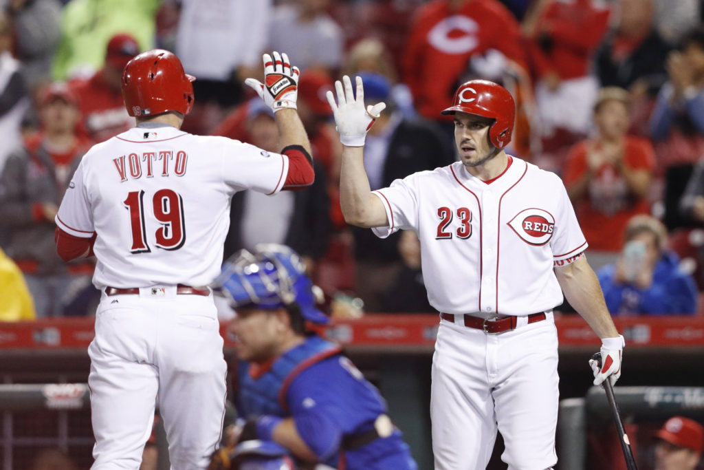 CINCINNATI, OH - SEPTEMBER 30: Joey Votto #19 of the Cincinnati Reds celebrates with Adam Duvall #23 after hitting a two-run home run in the ninth inning against the Chicago Cubs at Great American Ball Park on September 30, 2016 in Cincinnati, Ohio. The Cubs defeated the Reds 7-3.   Joe Robbins/Getty Images/AFP