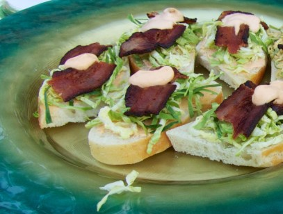 bread topped with shredded Brussel sprouts, Sriracha crème fraîche and bacon.