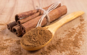 Powdery Cinnamon And Sticks On Wooden Table, Seasoning For Cooki
