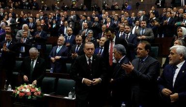 Turkey's President Tayyip Erdogan leaves his seat to address members of parliament from his ruling AK Party (AKP) during a meeting at the Turkish parliament in Ankara, Turkey, January 9, 2018. REUTERS/Umit Bektas