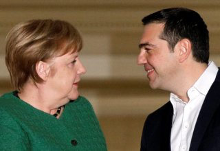 Greek Prime Minister Alexis Tsipras welcomes German Chancellor Angela Merkel at the Maximos Mansion in Athens, Greece, January 10, 2019. REUTERS/Alkis Konstantinidis