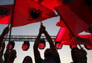 Supporters of prime minister Edi Rama wave Albanian flags during the last election rally in Vlora, southern Albania, Friday, June 28, 2019. Albania's municipal elections don't normally provoke much interest beyond the country's border, but the holding of this weekend's vote — or failure to do so — appears decisive for the tiny Western Balkan country in its bid to start full membership negotiations with the European Union. (AP Photo/Visar Kryeziu)