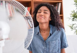 bigstock-Portrait-Of-Black-Girl-Cooling-303269344