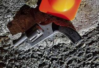 In this photo provided by the New York City Police Department, a hand gun recovered at the scene of a shooting sits on the pavement in the area where New York City police officer Brian Mulkeen was shot and killed early in the morning Sunday, Sept. 29, 2019, in the Bronx borough of New York. Mulkeen and his partner tried to apprehend a man who had fled questioning, and a struggle on the ground ensued. Mulkeen was struck by multiple bullets. (NYPD via AP)