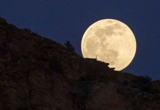 The full super snow moon rises, Saturday, Feb. 8, 2020, at Smith Rock State Park in Oregon. (AP Photo/Ted S. Warren)
