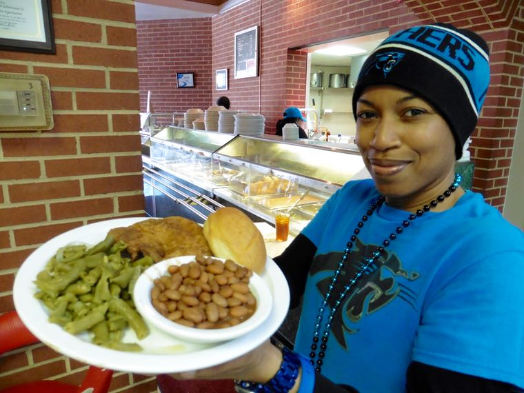 Server Deanna Young at the United House of Prayer cafeteria near Panthers Stadium.