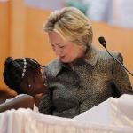Nine-year-old Zianna Oliphant joins U.S. Democratic presidential nominee Hillary Clinton at the pulpit at the Little Rock AME Zion Church in Charlotte, North Carolina, United States October 2, 2016.  REUTERS/Brian Snyder