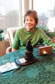 Julie admires her three trophies; the first Lady Putter to win all three categories in one time period, possibly in the history of the club. Photo by Roger Oravetz