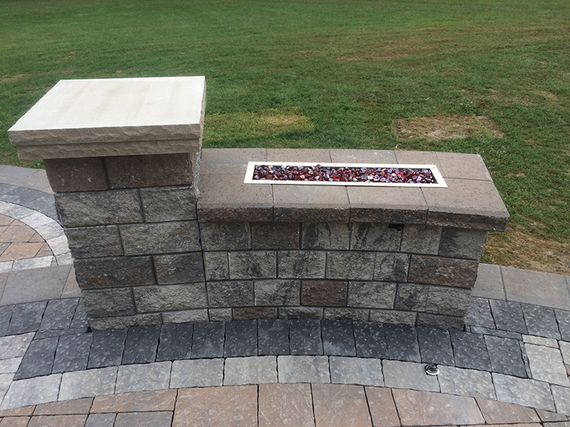 Custom Brick Paving with a Built in Firepit