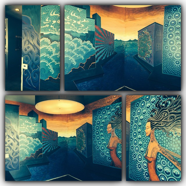 Breaking Through. Squid Ink Peoria Bar Mural. Painted on two walls forming a corner.