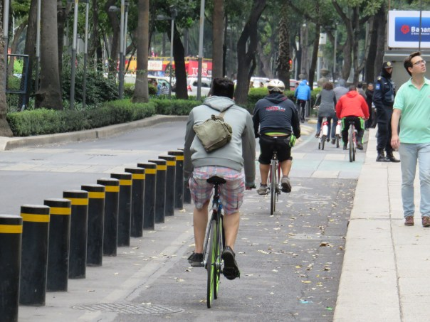 The bike lanes on Paseo de la Reforma are separated from auto traffic by metal posts.