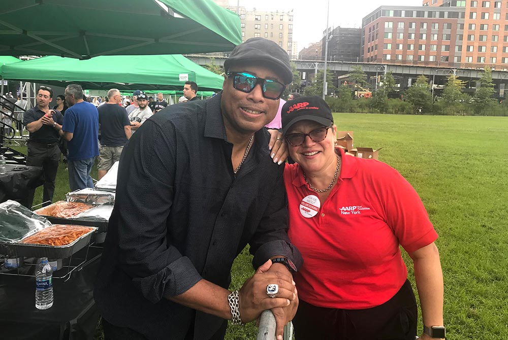 Bernie Williams, former New York Yankee and Maggie Castro, AARP New York, Associate State Director.