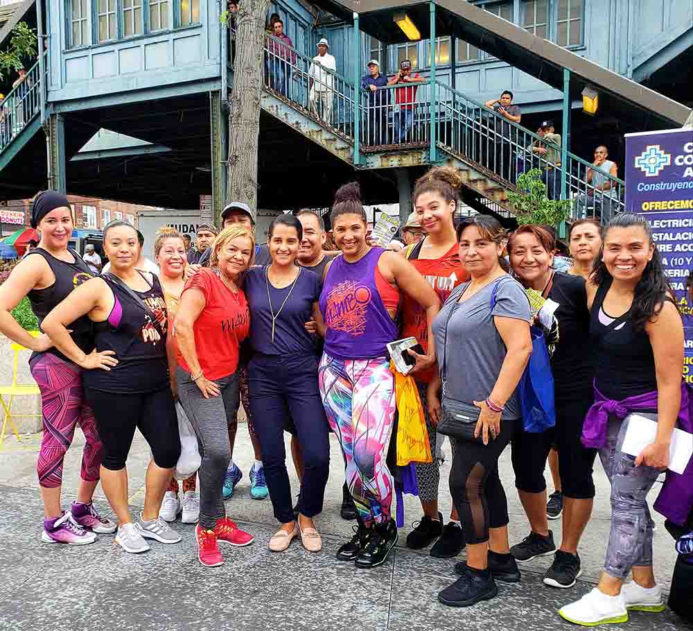 Assemblywoman Ari Espinal, at center in blue, with women after exercising.