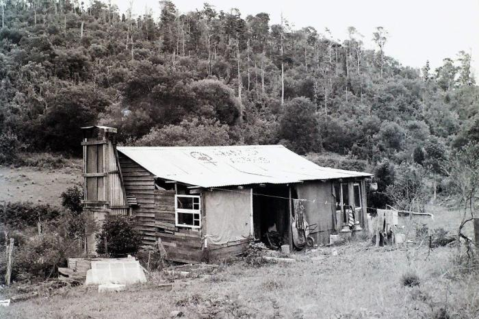 14a Hut with Amazon Acres painted on the roof. 1978