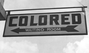 1943 hanging sign in the South of the USA for the segregated waiting room for coloured people