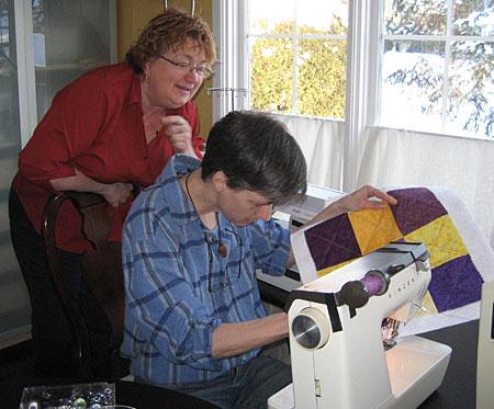 Lois and Sinead quilting the nine patch.
