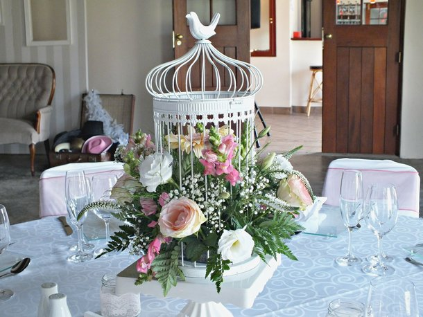 wedding centrepiece flowers in white birdcage