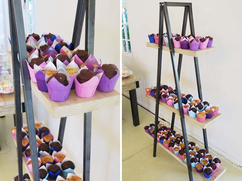 Cupcakes displayed on rustic tripod stand - Quirky Parties