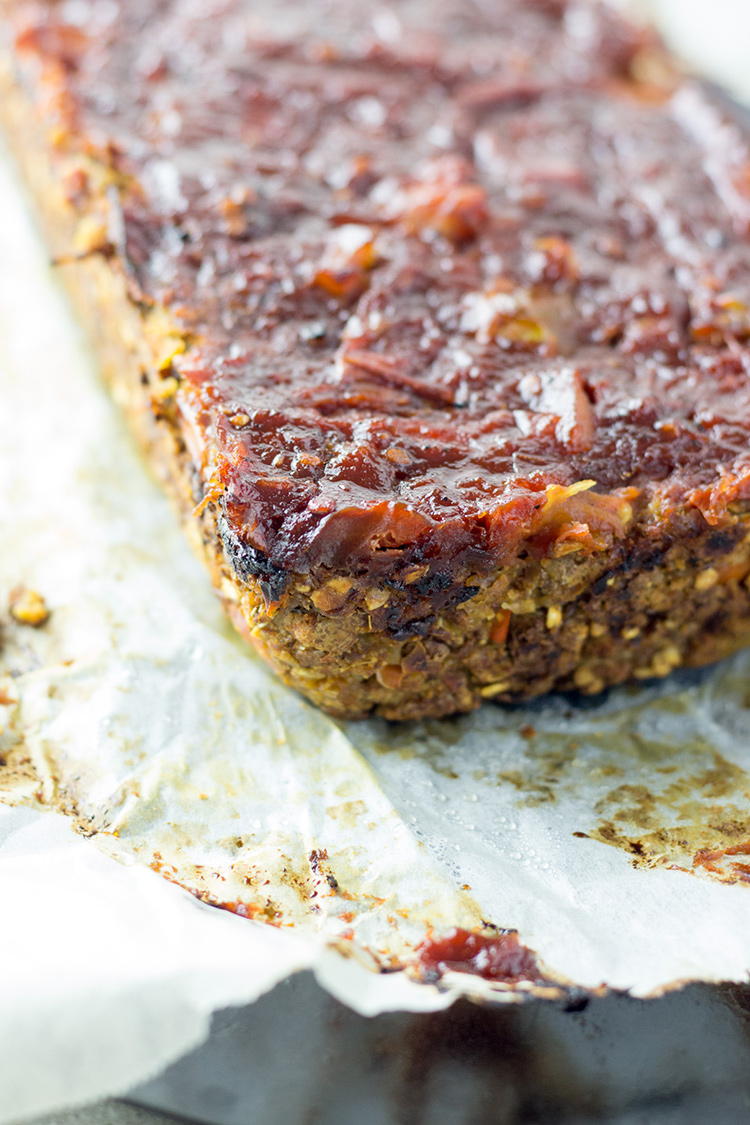 This glazed vegan loaf is made with lentils, walnuts, vegetables, oats ...