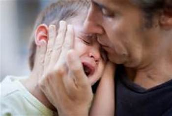 Sad father with crying son