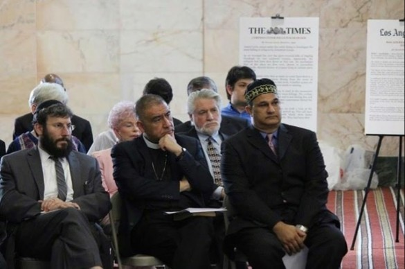 Seated left to right: Rabbi Yonah Bookstein, Bishop Juan Carlos Mendez of the Centro Cristiano Bet-El and Mahomed Khan.