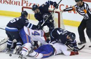 theres-a-crowd-in-the-winnipeg-jets-crease-as-they-take-on-t