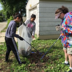 Citalli and Alexis Nicholas and Pam Carey worked in a vacant lot Saturday. Citalli will be a freshman at Case this fall, and she said she sees too much garbage in her neighborhood and it was time to do something about it.