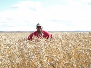 Athan Lindsay, Come to the Table's Faith Community Outreach Coordinator, in a North Dakota field.
