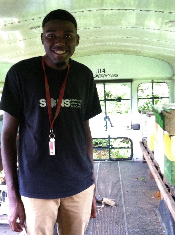 Tobias Hopkins on the Bee Bus at Conetoe Family Life Center Farm