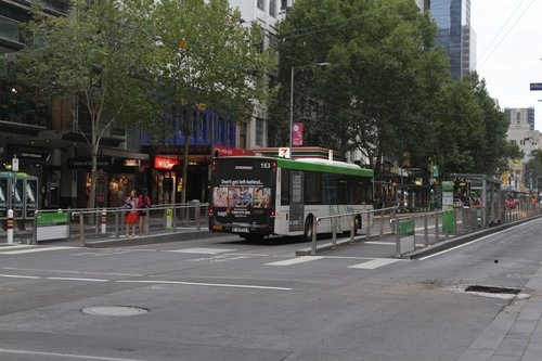 Having reversed out of the tight corner, a route 19 replacement bus turns to the wider tram lanes