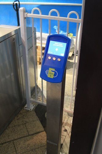 Myki check reader hidden in a corner at Melbourne Central