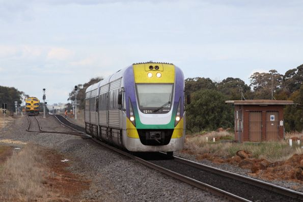 VLocity VL11 on a down Ballarat service at Parwan Loop, running past an El Zorro operated grain train
