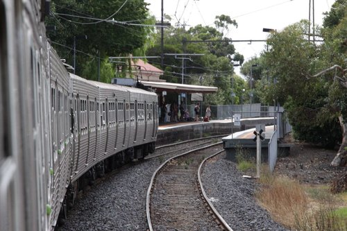 Arriving into Williamstown Beach on a Hitachi, a dozen waiting passengers on the up platform looking over to a corpse