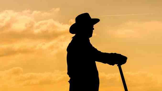 Farmer and sunset