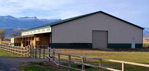 An equestrian building with enclosed riding arena.