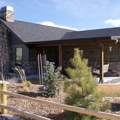 Craftsman style home with stone and wood siding.