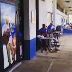 Grand Cayman Airport has a welcome band, sets the mood…