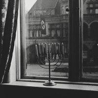 A Jewish menorah defies the Nazi swastika, 1931